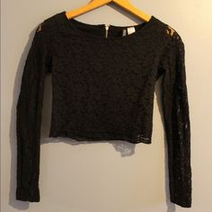 Black Long-Sleeve Lace Crop Top from Divided by HM Worn 3-4 times and in great condition. Says size 4 but I personally think this runs small - the arms are pretty tight. Can be worn with an A-line skirt for an elegant look or black leather pants for a more edgy feel. Divided Tops Crop Tops