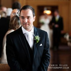 nervous groom at the alter waiting for his bride