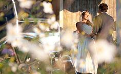 Veranda ceremony shot through flowers   A Charlottesville wedding photo taken at Pippin Hill Farm & Vineyards