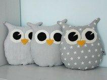 Three owls plushies .