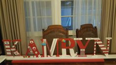 Personalized  center piece for party favor table. Cardboard block letters purchased from Walmart along with paint, stickers, and rhinestones to add nice touch.