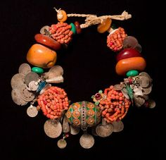 Moroccan necklace from the 20th century. Silver, coral, enamel, glass, coins, shells, cotton, plastic, and buttons. From the Draa Valley.