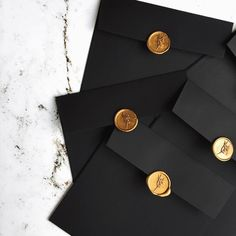 Black envelopes with gold wax seals. Wedding Stationery, Wedding Invitations, Invites, Black Envelopes, Wax Seal Stamp, Jewelry Packaging, Paper Goods, Invitation Cards, Wedding Cards