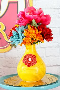 Decorations can be simple, just a couple of bright colored vases and flowers bring lots of life to the party table.