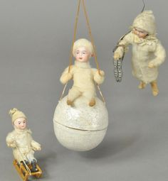 Lot includes: Germany, pressed cotton girl with metal ice skates, girl on wooden sled, and pressed cotton with bisque head girl sledding on snowball candy container. (VG-Exc. Cond.), Snowball (Pristine Cond.)