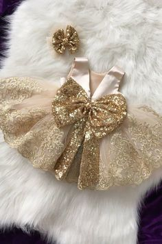 This dress comes with a gold sequin bow placed on the back. The trim on this dress is a gold lace. - Baby Girl Dress - Ideas of Baby Girl Dress Baby Girl Frocks, Baby Girl Party Dresses, Kids Frocks, Frocks For Girls, Dresses Kids Girl, Flower Girl Dresses, Bow Dresses, Baby Outfits, Cute Baby Dresses