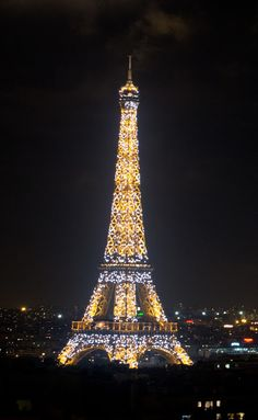 View of the Eiffel Tower at night from the Arc de Triomphe! The lights go off every hour after sun down until midnight.