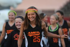 Ames softball team passes through during the march past the opening ceremony of Iowa Games at Jack Trice Stadium Friday, July 15, 2016, in Ames, Iowa. Photo by Nirmalendu Majumdar/Ames Tribune