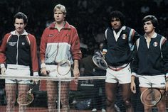 The doubles match in the 1982 Davis Cup final.The USA team defeated France 4 - 1.Pictured left to right are; John McEnroe (USA), Peter Fleming (USA),Yannick Noah(France), Henri Leconte (France).McEnroe is using a Dunlop Maxply McEnroe racket.Leconte seems to have a Head racket like the V-24,or Edgewood.