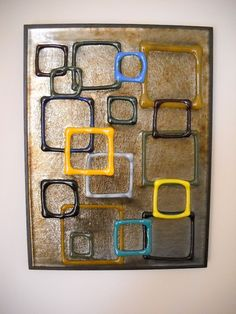 Fused glass wall collage. $50.00, via Etsy.