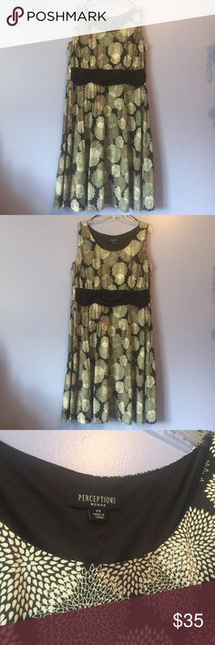 Perceptions Black and White Floral Dress This is a cozy dress! It is a size 2X and It has never been worn! It is made from 96% polyester and 4% spandex. I am open to offers and will give good discounts if you bundle! perceptions Dresses Midi
