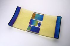 Geometric 4 Green By Jeri Goodman GlassArt  A geometric design in rainbow irid rectangles on a pale green field.