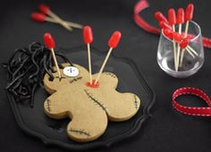 Voodoo Doll Cookies - They're like precious little gingerbread voodoo dolls. Not big on baking, but these are simultaneously evil AND adorable; what's not to love? Had to repin'em..