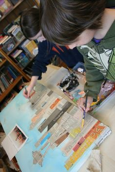 Collaging newspaper buildings onto a sky blue background, then layers of tinted acrylic paints to make city skylines. Collaborative art project