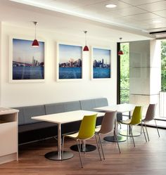 Scenic images, pendant lighting and cafe style seating create a bright, informal meeting or breakout area
