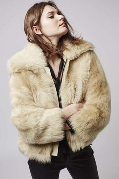 Real sheepskin and a classic shape make this jacket a piece to invest in. With a soft collar and a short, bomber shape that make this premium jacket a wardrobe must-have. Style with leather and heavy embellishments for a rebellious model-girl look. #Topshop