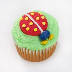 "Ladybug Cupcakes--Nestled on a bed of frosting ""grass,"" this ladybug cupcake showcases lots of colorful charm in an easy-to-create design perfect for your bug lover's next birthday."