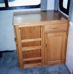 Storage for whatever. Add drop leaf for dining table. Desks For Small Spaces, Mobile Office, Dining Area, Dining Table, Organizing Your Home, House On Wheels, Clutter, Bathroom Medicine Cabinet, Rv Decorating