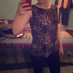 Leopard print dressy tank This is great with a black cardigan or blazer. Super stretchy as you can see in the picture. It just hangs on the body very nicely. It is very comfortable. No damages, nothing wrong at all! BUNDLE for more discounts! AGB Tops Tank Tops