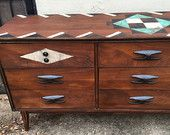 Mid century modern Bassett Furniture Industries console or dresser refinished and stenciled tribal design aztec design natural finish walnut