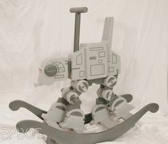 star wars toy - This Star Wars toy uses sci-fi to jazz up a tried and true toy design. The Star Wars rocker takes on the style of an AT-AT and comes with an accura. Star Wars Nursery, Star Wars Room, Star Wars Baby, Nerd Baby, Star Wars Kindergarten, At-at Walker, Star Wars Zimmer, Nave Star Wars, Baby Kostüm