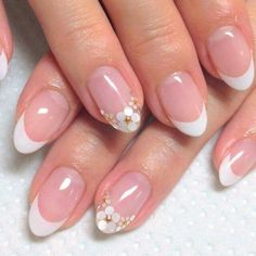 Gorgeous French manicure with flower detail.