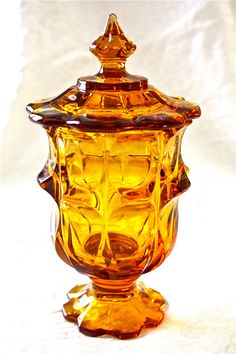 Vintage amber candy jar-covered candy jar-amber glass-coered candy dish-wedding candy table. $40.00, via Etsy.
