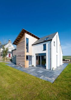 A Characterful Kit Home via Homebuilding & Renovating. Ellen and John McCann's homebuilding journey has culminated in the contemporary, one and a half storey, timber frame new build they have dubbed 'Minister's Walk'. Cheap Building Materials, Oak Framed Buildings, Self Build Houses, Prefabricated Houses, Building A New Home, Building Ideas, Build Your Dream Home, Scandinavian Home, Kit Homes