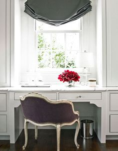 Window treatment, velvet upholstered French chair, white cabinets and drawers, fuschia flowers. All so beautiful :::