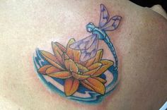 This is kinda what I want in my next tattoo.....  I want a dragonfly flying out from a lotus flower!!!