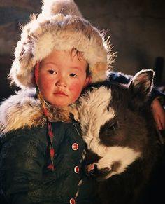 Tibetan boy and his calf.