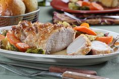 Here's a pork dinner that's just as great on a weeknight as it is for a special Sunday supper. Our Brown Sugar-Glazed Pork Roast is a sheet pan dinner that f. Mr Food Recipes, Pork Recipes, Cooking Recipes, Pan Cooking, Dinner Recipes, Pork Meals, Game Recipes, Yummy Recipes, Recipies