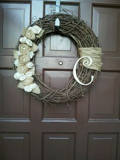 (total cost $5 to $7) A twig wreath (2.99 at Joanna, 2.99 at Michaels with 40% off coupon) 1/2 yard of Burlap  or 1/4 yard of two colors (non-patterned ones are on sale at Joann's for 2.99 per yard) Twine (frugal option is to use strands from left over burlap) Pearl beads  Optional Monogram letter