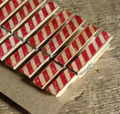 candy-striped clothes pins to hang Christmas cards