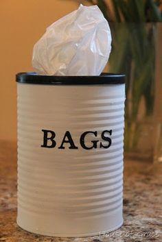 Cute storage for or trash bags or all those pesky store bags that get re-used for trash bags in the bathrooms.