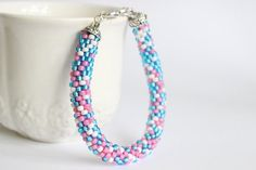 Bead crochet rope bracelet in pink, blue and white by BibaStore on Etsy