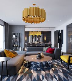 designers Elvin Aliyev and Leyla Ibrahimova, there is significantly more color than we've seen in the previous spaces. While grey is certainly the background, stunning gold chandeliers and colorful throw pillows brighten things up. The natural wood floor even has a grey tint to it, but the addition of the wood grain (or is it grey-n?) makes it feel much warmer.
