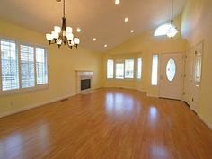 Large vaulted living room with fireplace