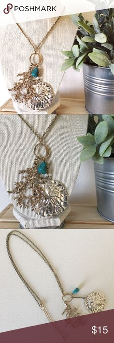 Beach inspired gold necklace with large charms This necklace will make you feel like the mermaid you are! From a special collection target had a very long time ago... great to wear at a seaside brunch! Slight tarnishing at the top, could come out with jewelry cleaner. Jewelry Necklaces