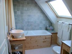 attic bathroom - very nice use of tight/under eave space ~ nice light colors/tile ~ big window/natural light ~ wow ~ fit a full bath in this small space ~ love it~