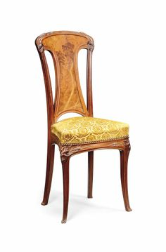A WALNUT AND FRUITWOOD MARQUETRY CHAIR BY LOUIS MAJORELLE, CIRCA 1900