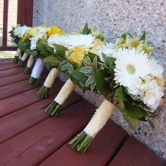 Yellow and white bridesmaid bouquets - White gerbera, white hydrangea, yellow alstromeria, yellow roses and greens. For more beautiful yellow wedding flower ideas you must check out http://www.weddingflowerbuzz.com/yellow-flowers-for-weddings.html