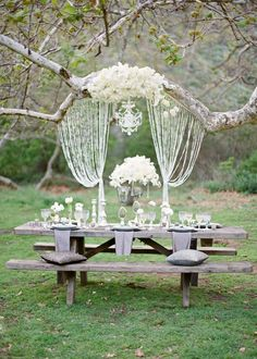 Love the idea of having a chandelier and crystals hanging by the alter and in the reception space.  Click for more hanging wedding decor.