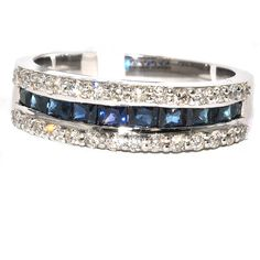 14kt White Gold Princess cut wedding band. This band showcases a center row of exquisite princess-cut bright blue sapphires, the traditional birthstone for September. These glorious gemstones are flanked on each side by rows of shimmering round diamonds for a total weight of 1.37 Carats for only $1315 ! . Only at Windy City Diamonds # W090930  #Shappire #14kt #Ring #weddingband   WWW.WINDYCITYDIAMONDS.COM