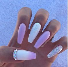 Long white and soft pink coffin nails with glitter and rhinestones