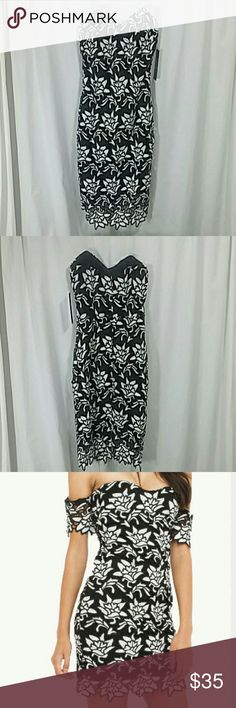 Black White Printed Sleeves Dress (NO SLEEVES) ATTENTION! DRESS DOES NOT COME WITH THE SLEEVES.  IT IS AS PICTURED IN THE 1ST PHOTO. This dress has a floral lace fabric that is lined for coverage. Dress closes with an invisible zipper and hook & eye at the back. Wear this with a short dainty necklace and heels for a special occasion.? Dresses