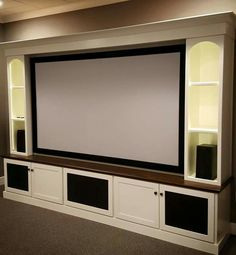 Maple home theater built-in with white lacquer and LED flextape lighting www.speckwoodwork.com