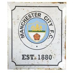 A metal home changing room sign bearing a retro Manchester City logo.