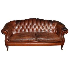 For Sale on - English Edwardian sofa in original leather upholstery, having rolled and tufted arms and back, two loose unbuttoned cushions, on turned legs with original Modern Sofa, Modern Furniture, Antique Furniture, Edwardian Architecture, Interior Design Courses, Office Set, Tufted Sofa, Dream Decor, Leather Sofa