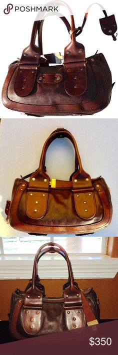 """WoW❣Chloe Saddle Brown 2tone Leather Shoulder Bag Chloe saddle in gorgeous rich two tone color. It's perfectly sized rare  in italian Leather with brushed golden  tone hardware, w/ two interior pockets with one additional zip pocket, top zip closure - 9"""" double handles over zipper top, 2 slot pockets, opening to tan clean canvas lined interior with zipper pocket and cell phone pocket - key attached for locking the bag -super clean and gorgeously well made! made in Italy Chloe Bags"""